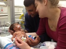Baby Dominic with mom and dad in the NICU